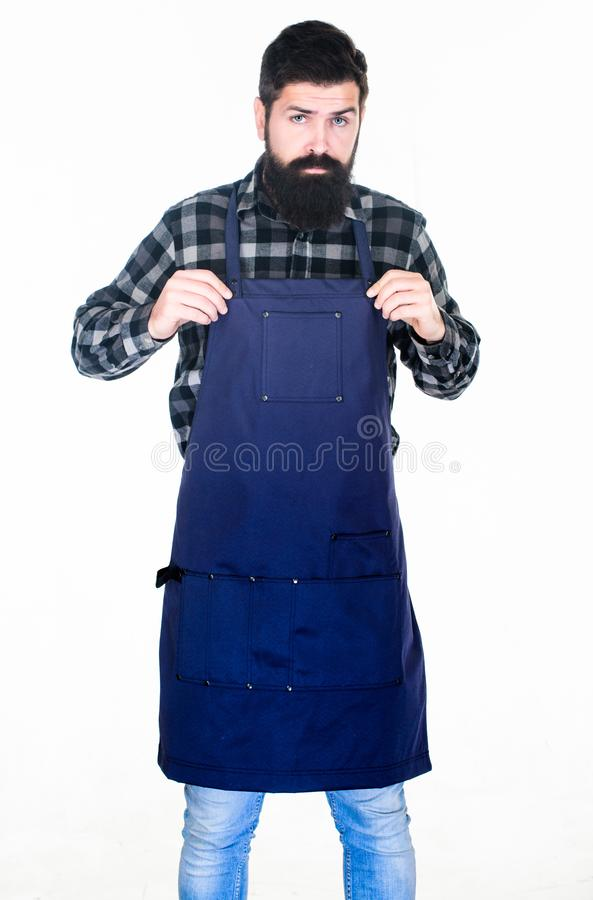 Picnic and barbecue. Man cook brutal hipster. Fast food restaurant. Serious bearded cook. Restaurant staff. Ready to. Cook. Bearded hipster wear apron for royalty free stock photos