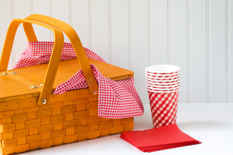 Picnic basket. With red gingham cloth stock photo