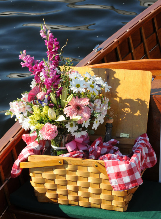 Picnic Basket With Flowers - On A Wooden Boat Stock Photo ...