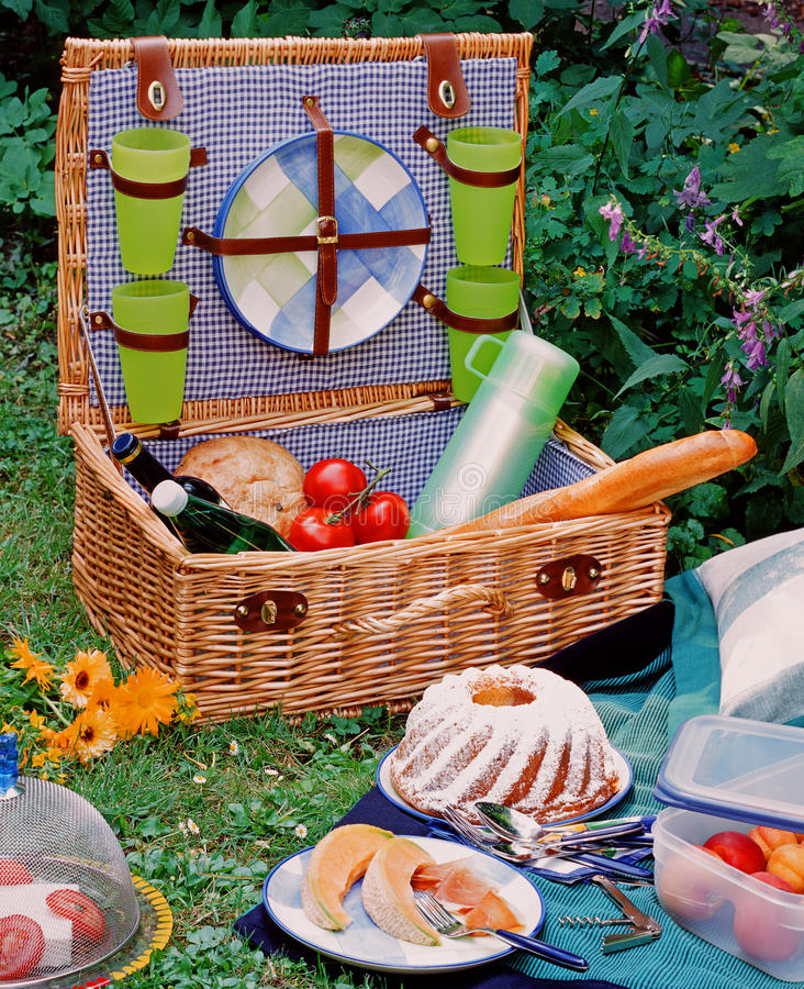Picnic basket. With fresh delicious food and drinks stock image