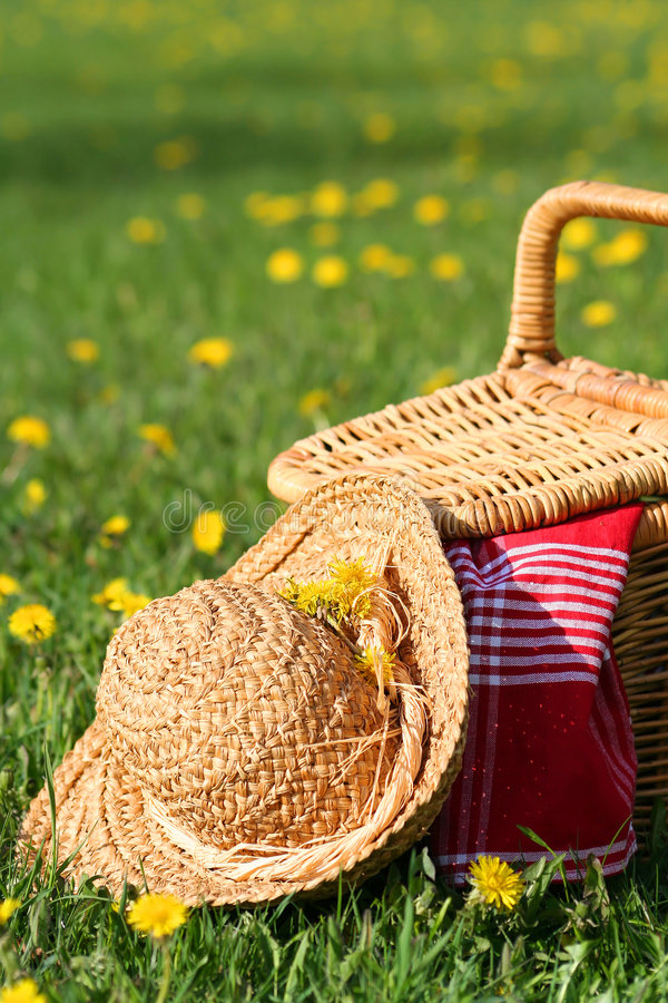 Picnic basket and hat stock image