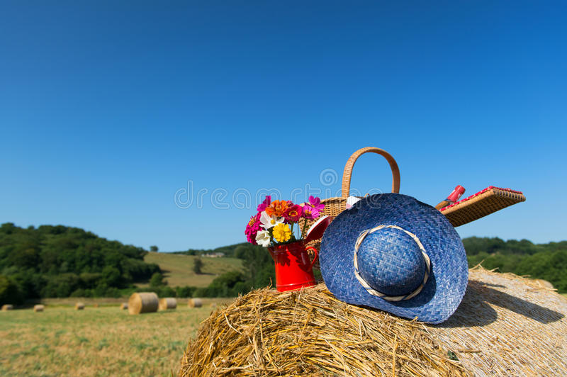 Picnic basket and summer hat in French agriculture landscape stock images