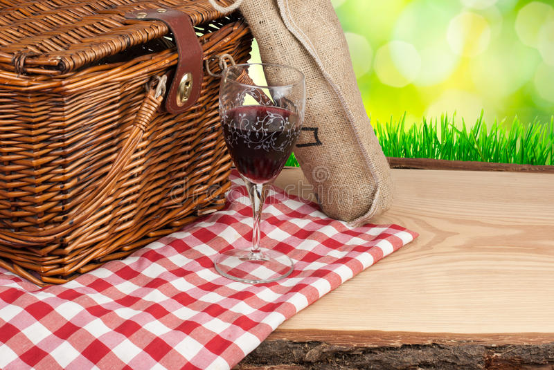 Picnic basket on the table and bottle of wine top angle.  stock photos
