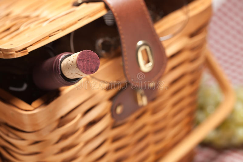 Picnic Basket, Wine Bottle and Empty Glasses royalty free stock image