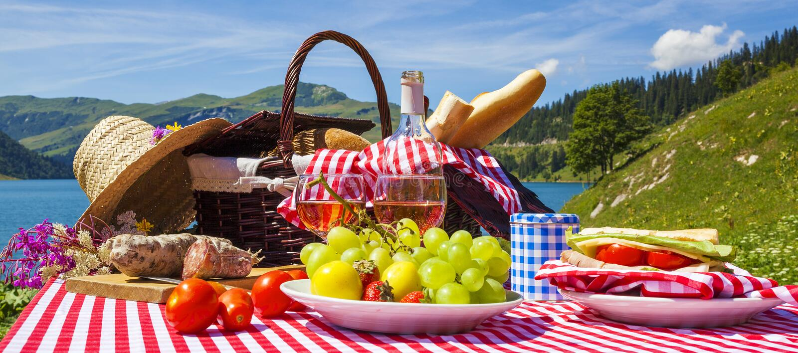 Picnic in french alpine mountains with lake royalty free stock photos