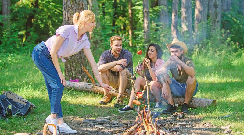 Picnic with friends in forest near bonfire. Company friends having hike picnic nature background. Summer picnic. Hikers. Relaxing during snack time. Tourists stock images