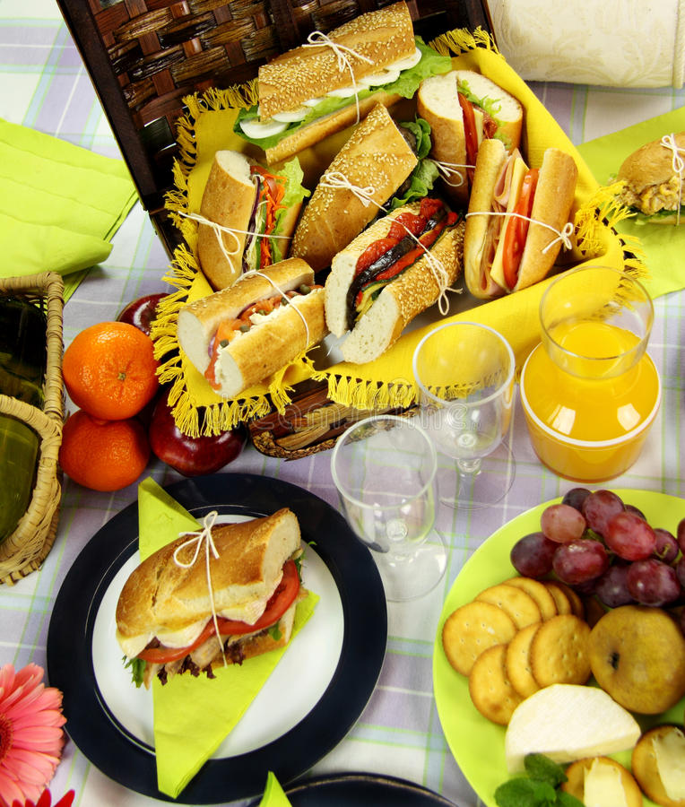 Picnic Hamper. Selection of food for a picnic with a hamper, basket and fruit royalty free stock images