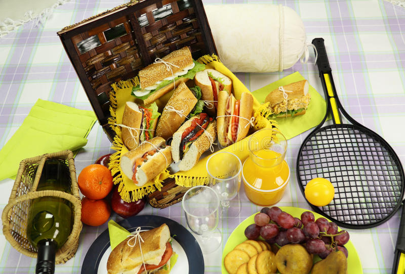 Picnic Hamper. Selection of food for a picnic with a hamper, basket and fruit stock photography