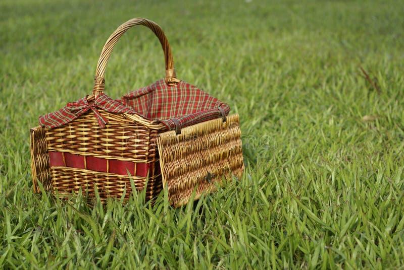 Picnic hamper in green grass. Picnic hamper basket in green grassy field stock images