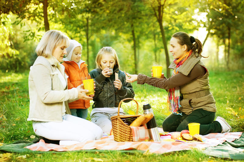 Picnic.Happy Family outdoors stock photography