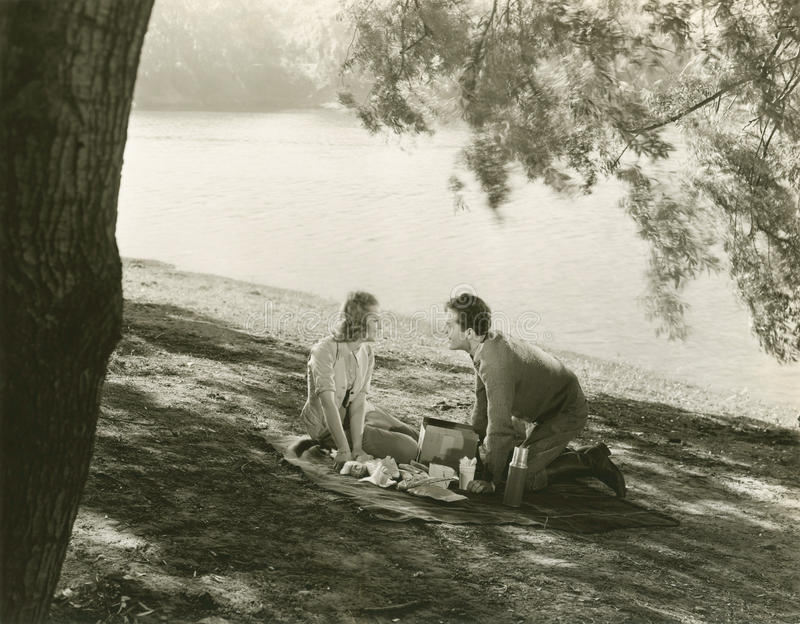 A picnic by the lake royalty free stock photo
