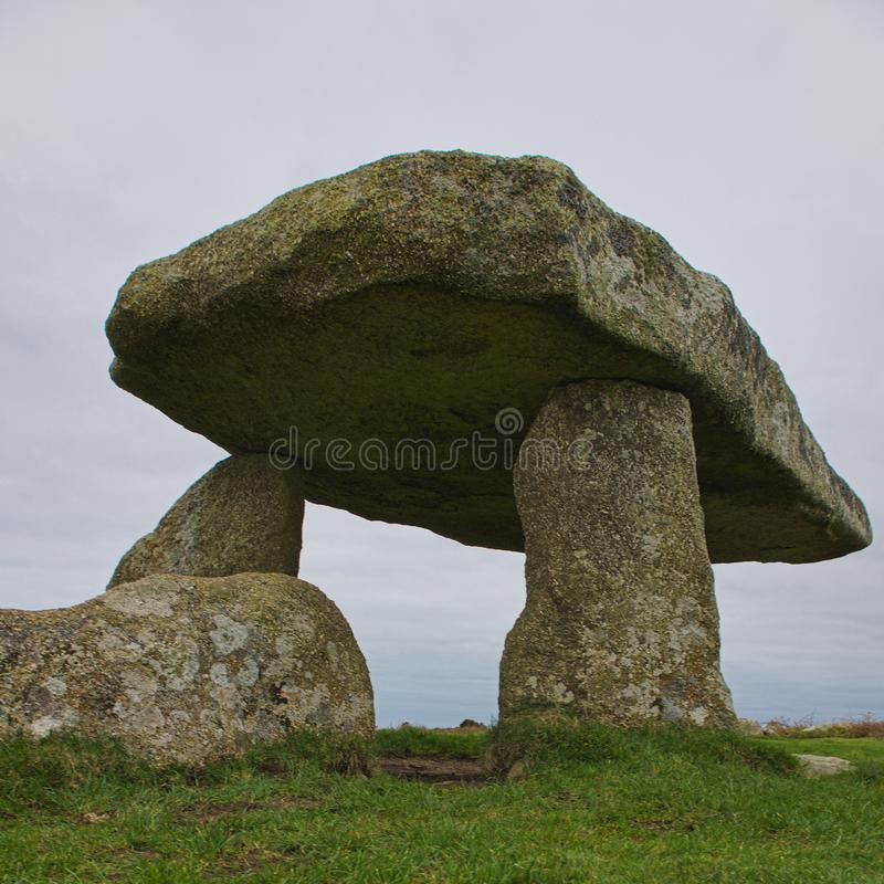 Picnic at Landon Quoit. Lanyon quoit burial chamber is a dolman in Cornwall England. It dates from the Neolithic period3500-2500bc. It collapsed in a storm stock images