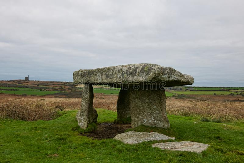 Picnic at Landon Quoit. Lanyon quoit burial chamber is a dolman in Cornwall England. It dates from the Neolithic period3500-2500bc. It collapsed in a storm royalty free stock image