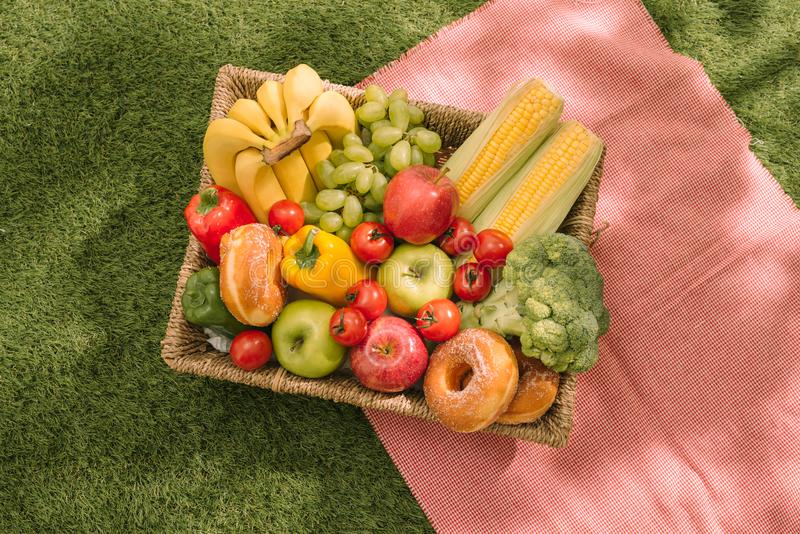 Picnic at the park on the grass: tablecloth, basket, healthy foo stock photography