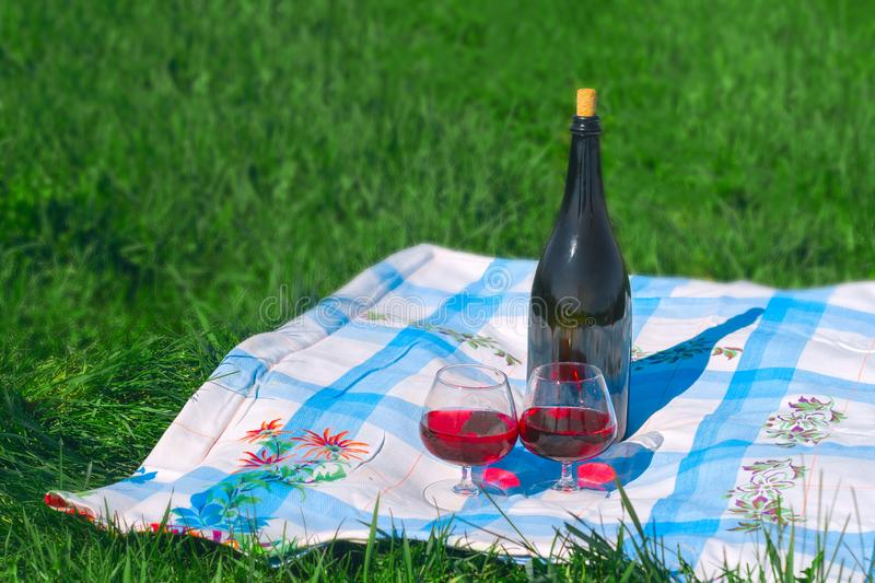 Picnic with wine outdoor, summer vacation concept. Picnic with red wine outdoor, summer vacation concept royalty free stock photos