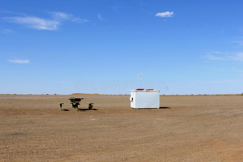 Picnic set in empty desert, Australian Outback. Picnic table and small benches at a rest area along the Stuart Highway in the desert, Northern Territory, Outback royalty free stock photography