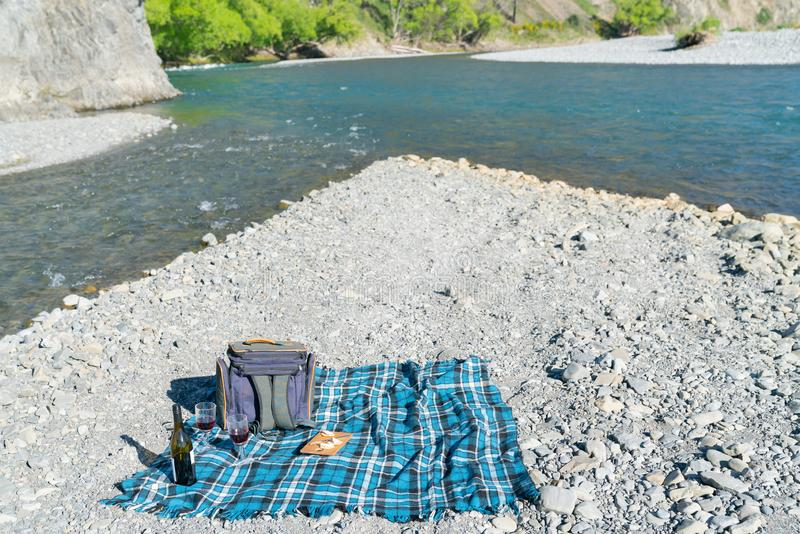 Picnic setting on stony river bed by fork in river. Picnic setting on stony river bed by fork in Waiau River outside tourist destination of Hanmer Springs stock photography