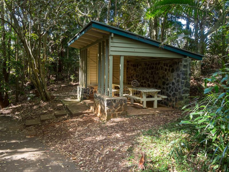 Picnic shelter covered seating area in a public rainforest park. Picnic shelter covered seating area alfresco in a public rainforest park stock image