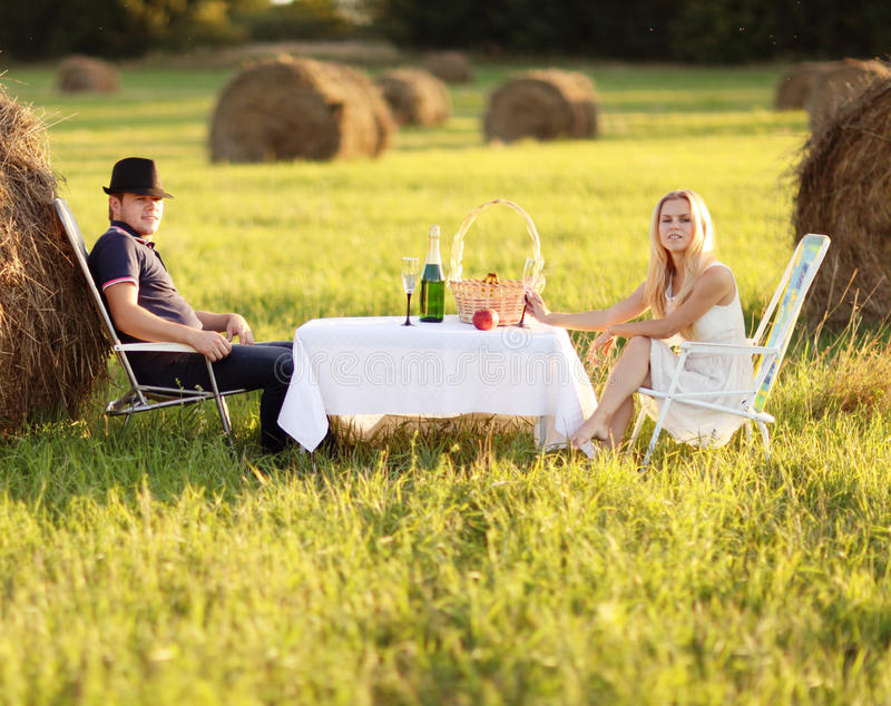Picnic in sunset field stock images