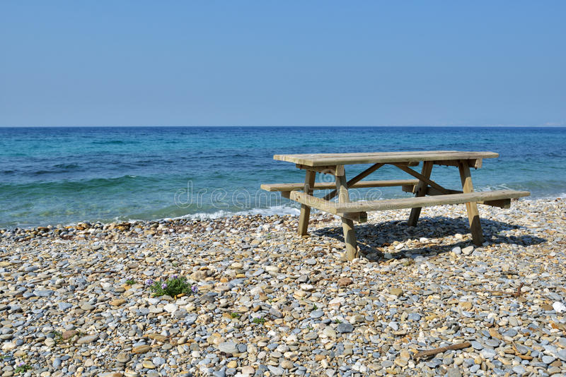 Picnic table on a beach royalty free stock images