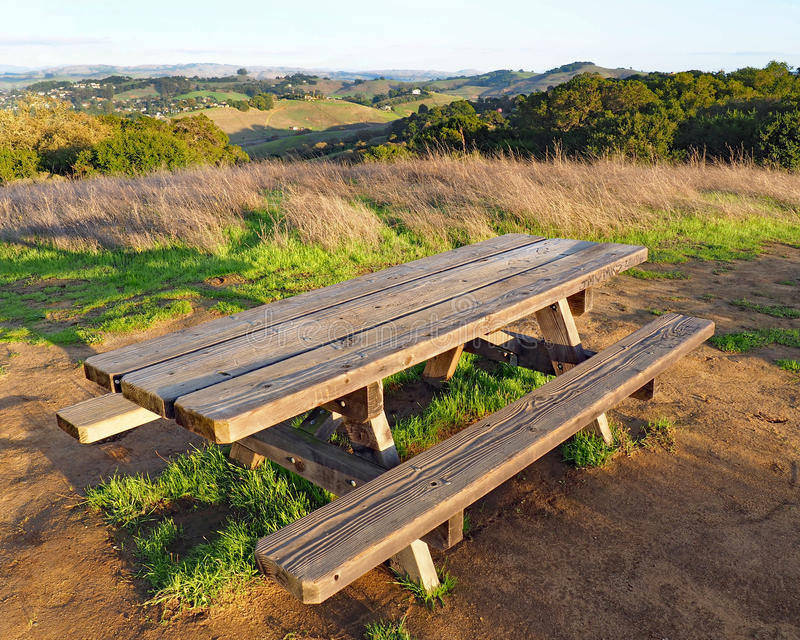 Picnic Table at Helen Putnam Park. Early rains bring autumn green to the hills outside Petaluma, California. A beautiful fall afternoon at Helen Putnam State royalty free stock image
