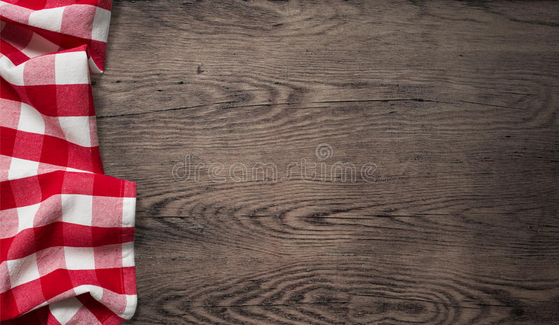 Picnic tablecloth on old wooden table top view stock photo