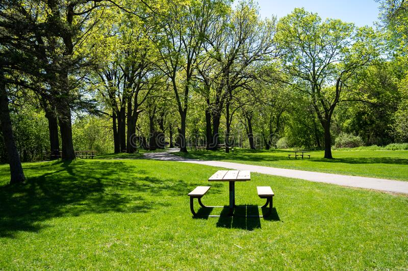 Picnic tables along trails inside of Clifton French Regional Park in Plymouth Minnesota.  stock images