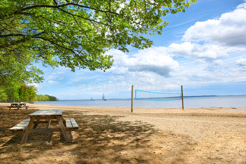 Picnic tables at the beach royalty free stock photography