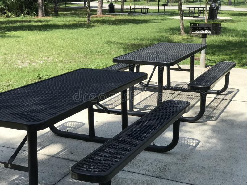 Picnic Tables Benches and Grill in Park. Photo Image royalty free stock photography