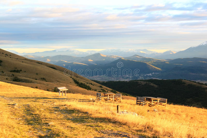 Picnic-tables in the mountains of Italy royalty free stock photography