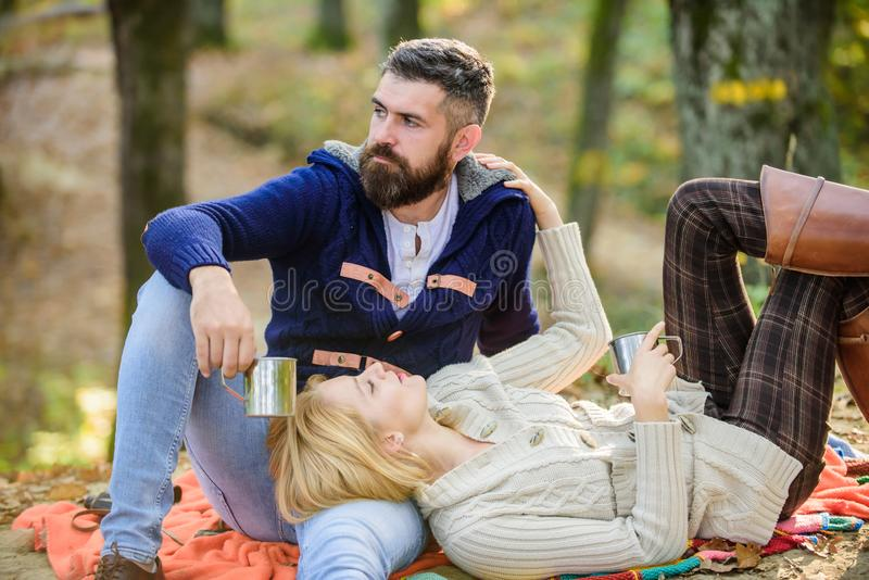 Picnic time. Happy loving couple relaxing in park together. Romantic picnic forest. Couple in love tourists relaxing on stock photography