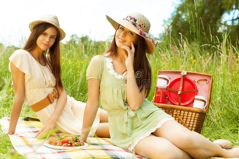 Picnic for two. Two girls are resting in park royalty free stock image