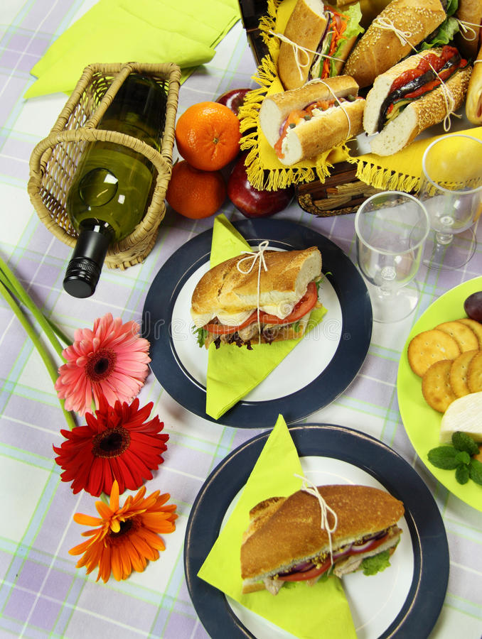 Picnic With Wine. Picnic rolls served with white wine and cheese and crackers royalty free stock image