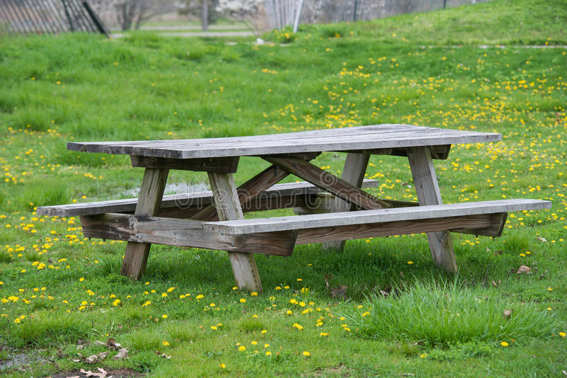 Picnic wooden table with benches in picnic and bbq family area in park royalty free stock photography
