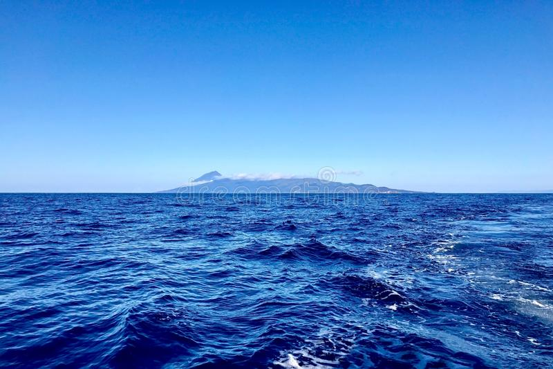 Pico Island in the Azores. Pico Island seen from around 20 miles offshore on a perfect day royalty free stock images