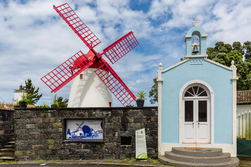 Pico Vermelho windmill on the coast of Sao Miguel Island. The Azores archipelago in the Atlantic Ocean belonging to Portugal royalty free stock images
