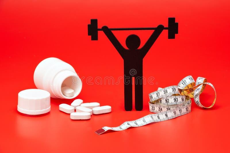 Pictogram för lyfta för vikt med piller, måttband royaltyfri fotografi