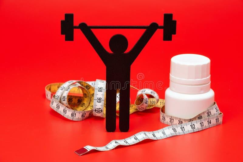Pictogram för lyfta för vikt med piller, måttband royaltyfria bilder