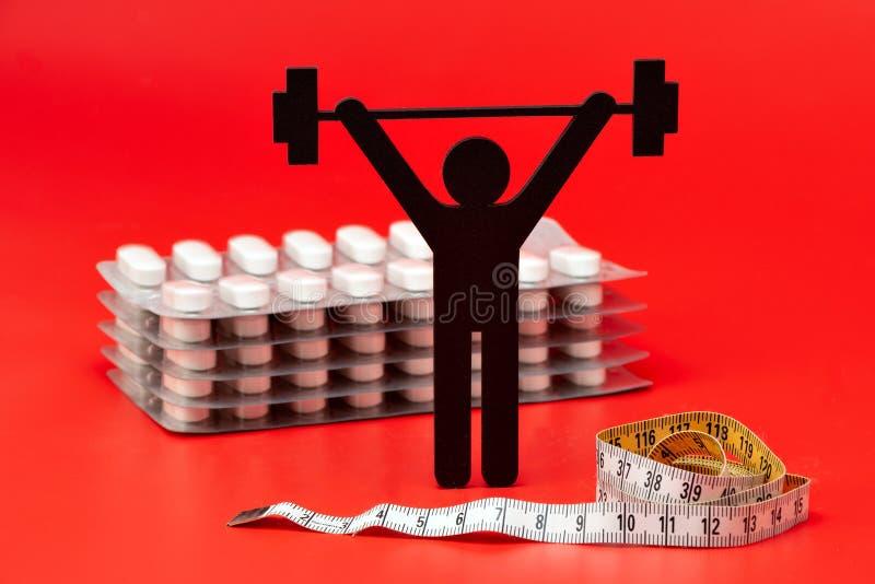 Pictogram för lyfta för vikt, piller, måttband royaltyfri foto