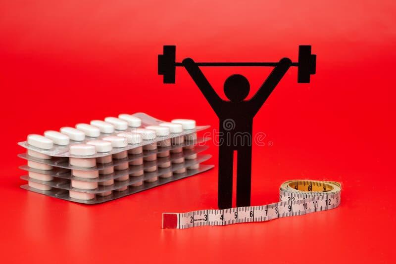 Pictogram för lyfta för vikt, piller, måttband royaltyfria bilder