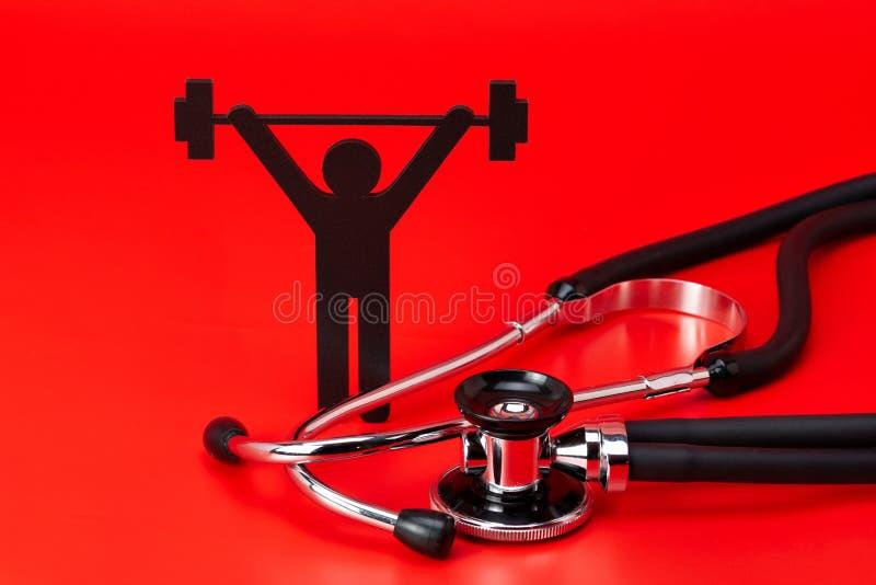 Pictogram för lyfta för vikt, stetoskop, närbild som isoleras royaltyfri foto