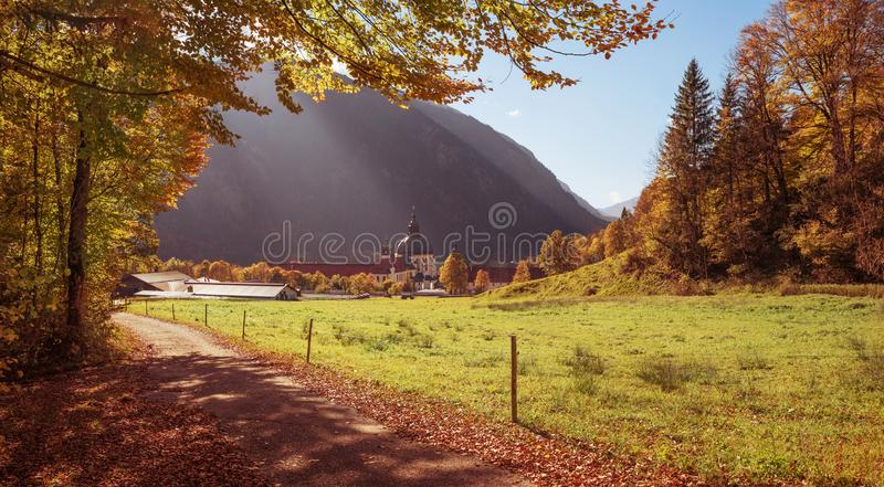 Pictorial bavarian autumn landscape with walkway around benedictine cloister ettal, germany stock images