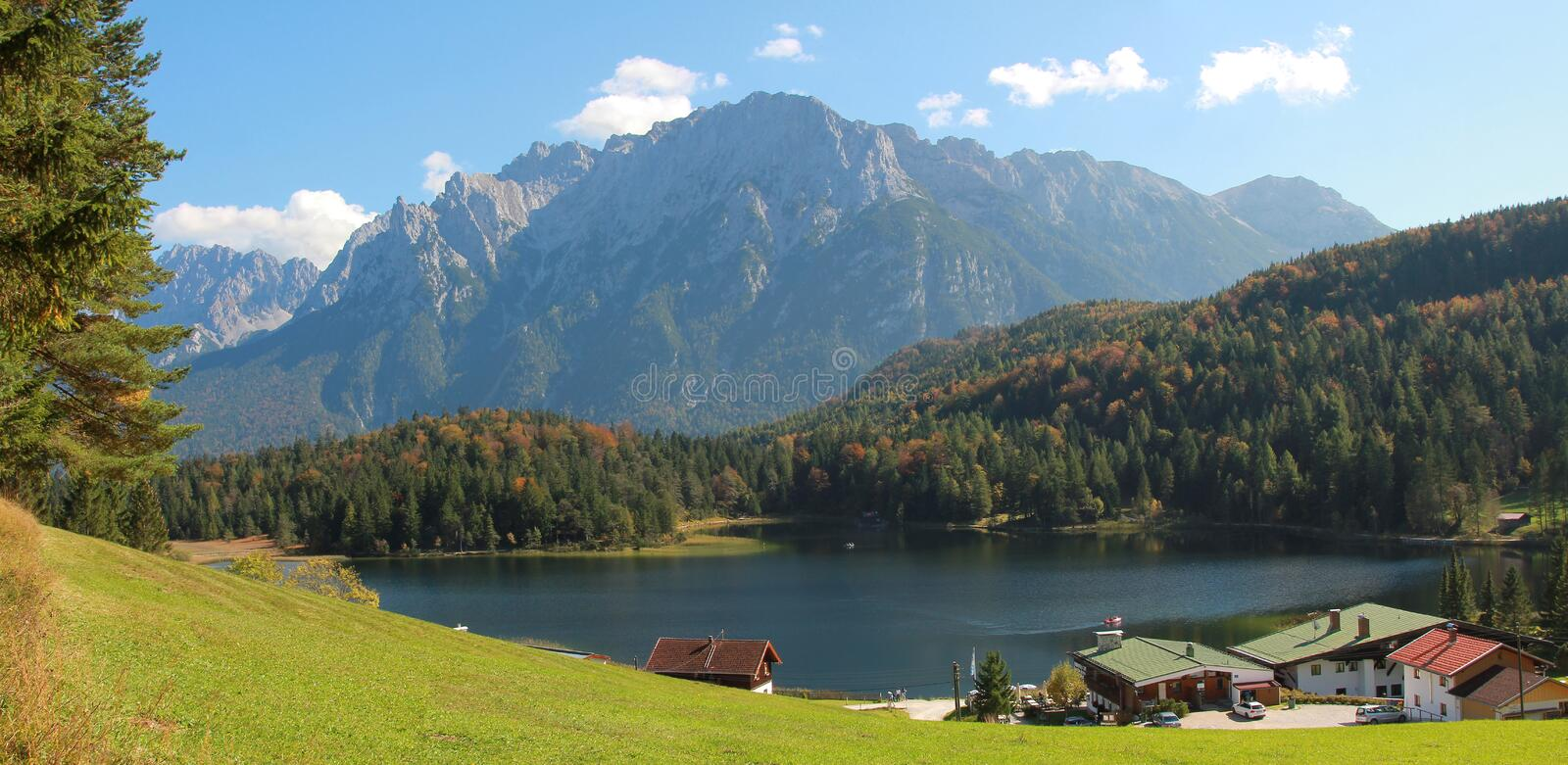 Pictorial bavarian landscape, lake lautersee and alps stock photography