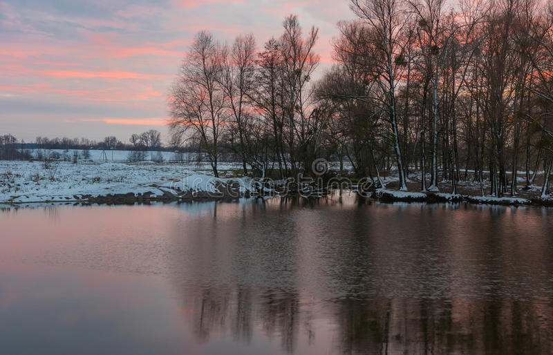 Pictorial evening landscape with small river. Hrun` at winter sunset time in Poltavskaya oblast, Ukraine stock images