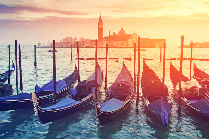 Pictorial view of blue gondolas in Venice. Italy. Color toning effect has been applied royalty free stock photography