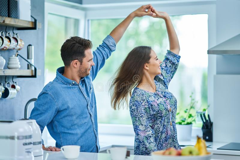 Adult couple dancing in the kitchen royalty free stock images