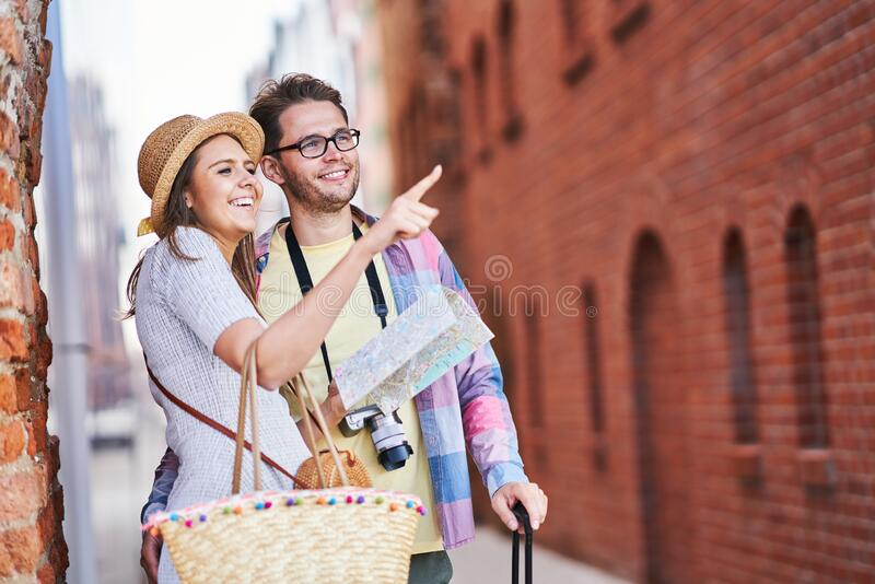 Adult happy tourists sightseeing Gdansk Poland in summer royalty free stock photo