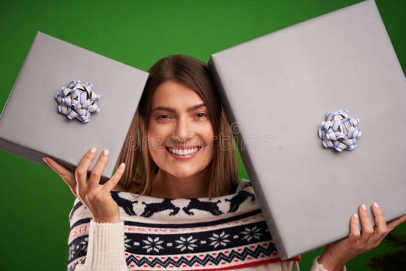 Adult happy woman with Christmas gift over green background stock images