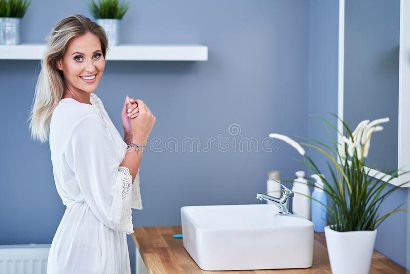 Beautiful woman in the bathroom. Picture of adult woman in the bathroom stock image