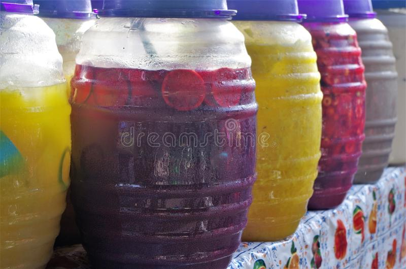 Picture Aguas frescas in a Honduras Market Tegucigalpa 2. Picture of line of aguas frescas of various flavors in a Honduras popular Market, tamarind, pinapple royalty free stock image